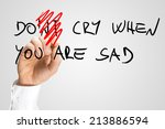 Small photo of Dont Cry When You Are Sad Black Hand Written Quotable Texts with Red Erasure. Over Grey Background.