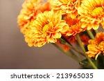 Chrysanthemums On Wooden...