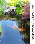 Koi Fish In A Small Decorative...
