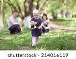 little girl walks in the park... | Shutterstock . vector #214016119