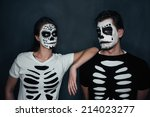 Loving couple with skull face...