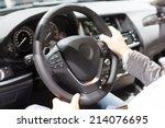 hands holding a steering wheel... | Shutterstock . vector #214076695