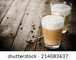 two glasses of latte coffee... | Shutterstock . vector #214083637