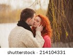 happy young couple embracing... | Shutterstock . vector #214104331