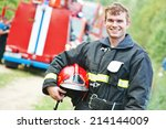 young smiling fireman... | Shutterstock . vector #214144009