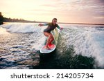 young woman surfboarding at... | Shutterstock . vector #214205734