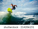 male surfer riding on waves in... | Shutterstock . vector #214206151