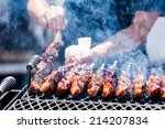 pork on skewers cooked on... | Shutterstock . vector #214207834