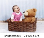 little baby girl with teddy... | Shutterstock . vector #214215175