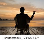 Silhouette Of Businessman Sit...