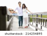 groom and bride standing on the ... | Shutterstock . vector #214254895