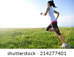 runner athlete running on grass ... | Shutterstock . vector #214277401
