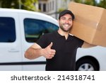 smiling delivery man holding a...