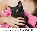 Woman Holding Cute Black Soggy...