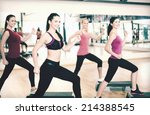 Small photo of fitness, sport, training, gym and lifestyle concept - group of smiling people doing aerobic