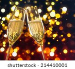 two champagne flutes with... | Shutterstock . vector #214410001