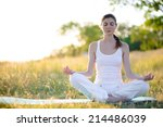 young beautiful woman practices ... | Shutterstock . vector #214486039