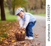 boy in a park with leaves and... | Shutterstock . vector #214503529