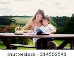 mother and son  reading a book... | Shutterstock . vector #214503541