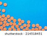 orange vitamin pills on a blue... | Shutterstock . vector #214518451