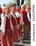 Small photo of Tallinn, Estonia - July 06, 2014: Parade of the Estonian XXVI National song and dance festival called Touched by time, Time to touch. Children�s choir in Tallinn, Estonia on July 06, 2014