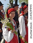 Small photo of Tallinn, Estonia - July 06, 2014: Parade of the Estonian XXVI National song and dance festival called Touched by time, Time to touch. Beautiful Estonian woman with flowers in Estonia on July 06, 2014