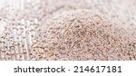 portion of psyllium seeds on... | Shutterstock . vector #214617181