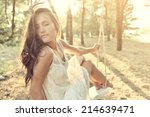 young woman is swinging on a... | Shutterstock . vector #214639471