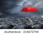 Red Umbrella In Mass Of Black...
