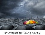 rainbow umbrella in mass of... | Shutterstock . vector #214672759