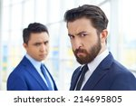 frowning businessman looking at ...   Shutterstock . vector #214695805