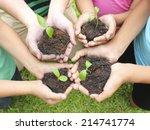 hands holding sapling in soil... | Shutterstock . vector #214741774