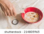 hand pour milk into cereals in... | Shutterstock . vector #214805965