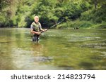 mature fisherman fishing in a... | Shutterstock . vector #214823794