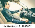 elegant man driving his car | Shutterstock . vector #214839001