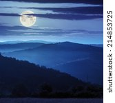cold morning fog before sunrise in the mountains at night in full moon light - stock photo