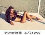 beautiful woman posing on sandy
