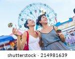 happy young women at luna park | Shutterstock . vector #214981639