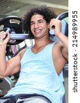 young man at workout in a gym   Shutterstock . vector #214989955