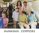 family sitting on airplane | Shutterstock . vector #215092261
