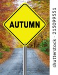 Small photo of Autumn ahead cautionary road sign against a fall background