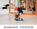 young sexy pole dance woman | Shutterstock . vector #215101234
