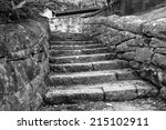 Black and white image of an old stone walkway leading down to the river at Babcock State Park, WV - stock photo