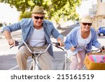 happy mature couple going for a ... | Shutterstock . vector #215161519