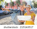 happy tourist couple using map... | Shutterstock . vector #215163517