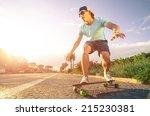 man on longboard skate at sunset | Shutterstock . vector #215230381