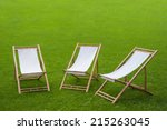 Three Folding Chairs In A Gree...