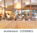 wooden table and blur... | Shutterstock . vector #215300821