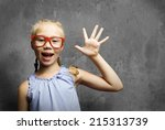 genius girl in red glasses near ... | Shutterstock . vector #215313739