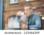 young man drinking coffee in... | Shutterstock . vector #215466349